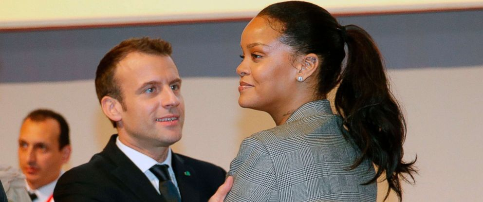 "PHOTO: French President Emmanuel Macron embraces Barbadian singer Rihanna as they attend the conference ""GPE Financing Conference, an Investment in the Future"" organised by the Global Partnership for Education in Dakar on February 2, 2018."
