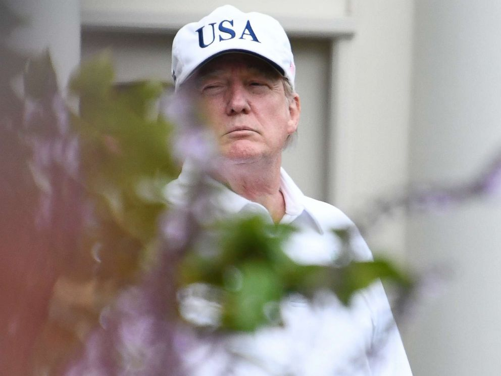 PHOTO: U.S. President Donald J. Trump stands in the First Ladys garden of the White House on October 14, 2017 in Washington, DC. Trump played a round of golf with Senator Lindsey Graham (R-SC) earlier in the day.