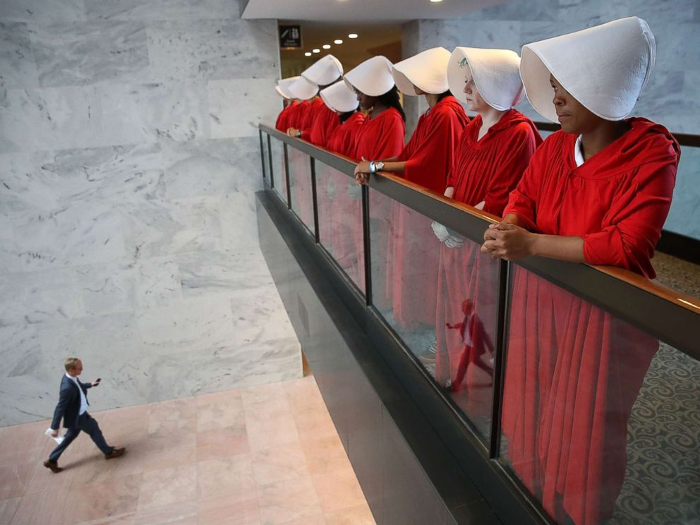 PHOTO: Protesters dressed in The Handmaids Tale costume, protest outside the hearing room where Supreme Court nominee Judge Brett Kavanaugh will testify before the Senate Judiciary Committee on Capitol Hill, Sept. 4, 2018, in Washington, D.C.