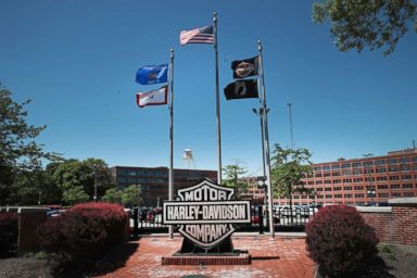 PHOTO: Flags fly in front of the headquarters of iconic American motorcycle builder Harley-Davidson on June 1, 2018 in Milwaukee, Wis.