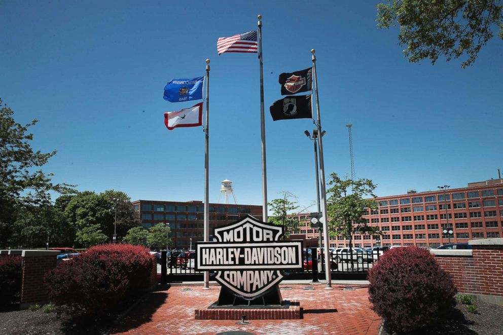 Flags fly in front of the headquarters of iconic American motorcycle builder Harley-Davidson on June 1, 2018 in Milwaukee, Wis.