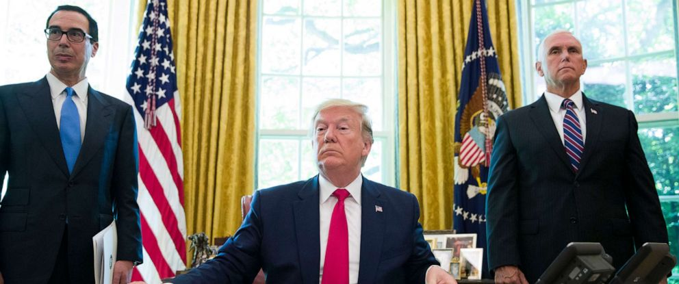 PHOTO: President Donald Trump listens to a reporters question after signing an executive order to increase sanctions on Iran, in the Oval Office of the White House on June 24, 2019.