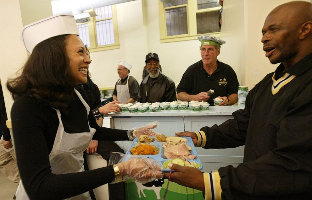 PHOTO: Then San Francisco district attorney candidate Kamala Harris, left, serves lunch to an unidentied visitor while volunteering at Thanksgiving service at Glide Memorial United Methodist Church in San Francisco on Thursday, Nov. 27, 2003.