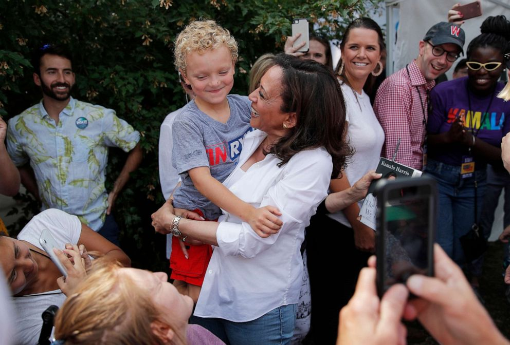 PHOTO: Democratic presidential candidate Sen. Kamala Harris holds Brady, the son of Democratic presidential candidate Rep. Tim Ryan, D-Ohio, at the Iowa State Fair, Saturday, Aug. 10, 2019, in Des Moines, Iowa.