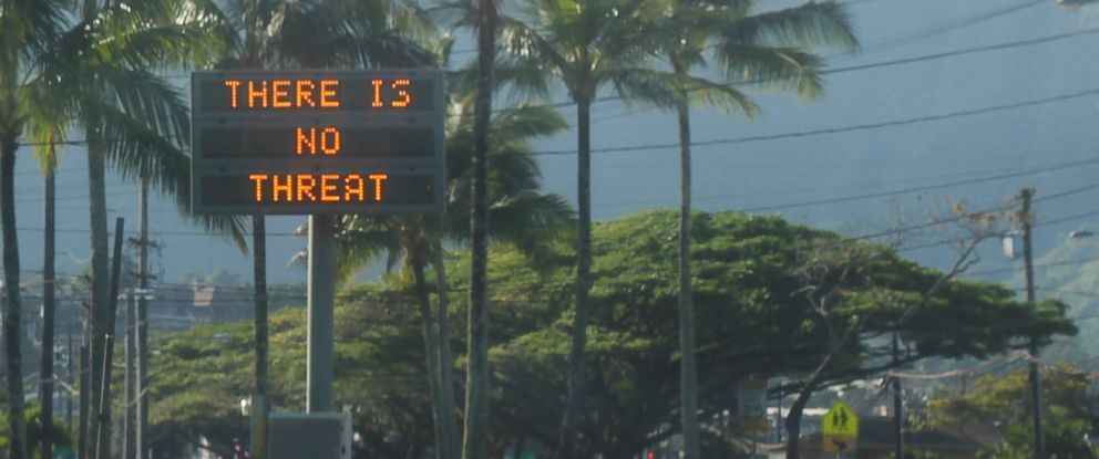 """PHOTO: This Jan. 13, 2018, photo provided by Jhune Liwanag shows a highway median sign broadcasting a message of """"There is no threat"""" in Kaneohe, Hawaii."""