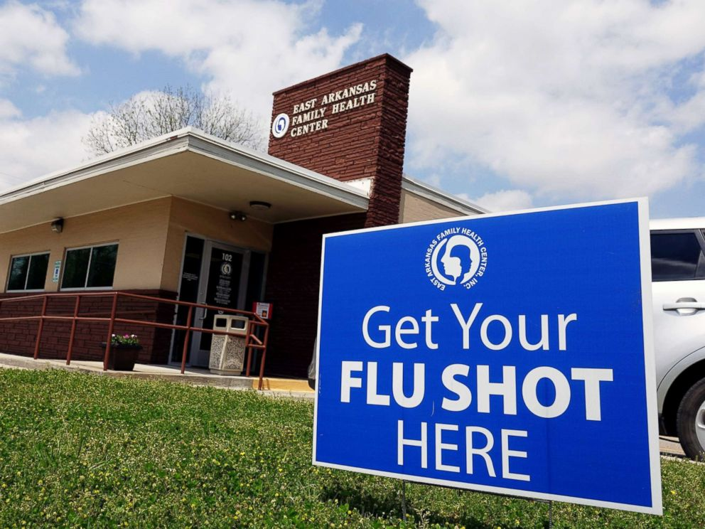 PHOTO: A sign reads Get your flu shots here outside of the East Arkansas Family Health Center in Lepanto, Ark., May 2, 2018.