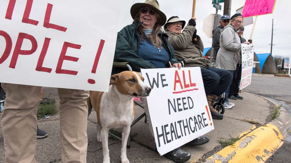 Protesters hold a small peaceful demonstration in support of health care on Sept. 23, 2017 in Livingston, Montana. The state of Montana expanded Medicaid under the Affordable Care Act.