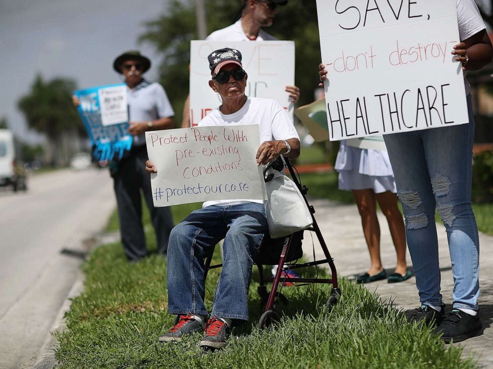 PHOTO: People protest in Miami, Fla., Aug. 3, 2017, against cuts to Medicaid and the Affordable Care Act.