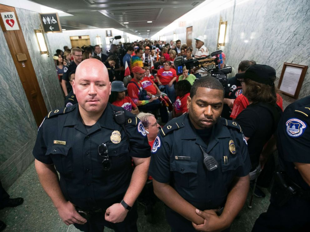 PHOTO: Capitol Police maintain order as hundreds of people, many with disabilities, arrive for a Senate Finance Committee hearing on the last-ditch GOP push to overhaul the nations health care system, on Capitol Hill in Washington, Sept. 25, 2017.