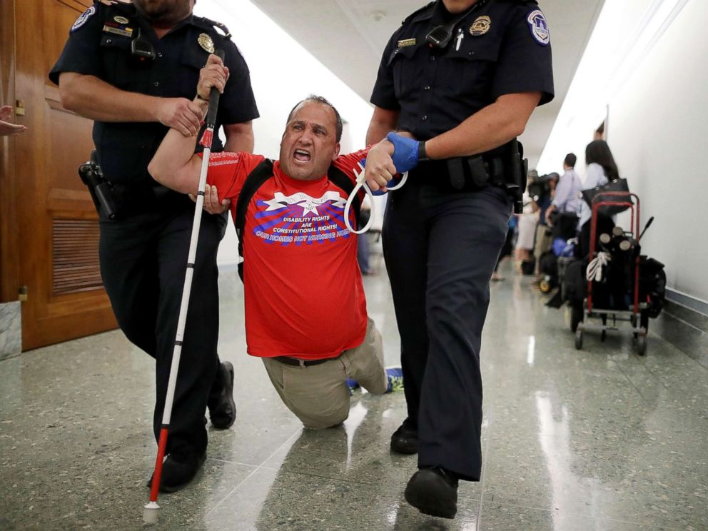 PHOTO: Capitol Police drag a blind protester out of a Senate Finance Committee hearing about the proposed Graham-Cassidy Healthcare Bill in the Dirksen Senate Office Building on Capitol Hill, Sept. 25, 2017, in Washington.