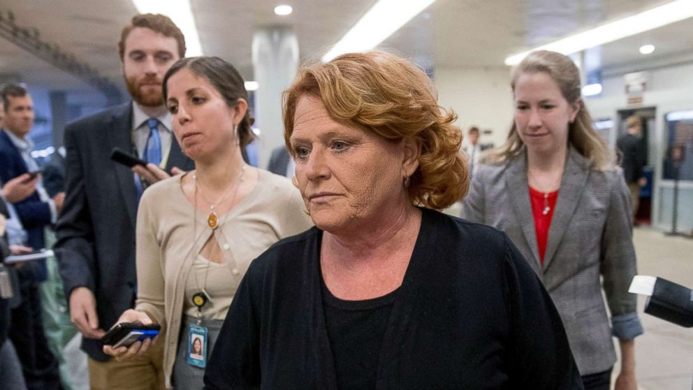 """In this Sept. 25, 2018 file photo, Democratic Sen. Heidi Heitkamp walks through the Senate Subway as she arrive at the Capitol, in Washington. Heitkamp suggested on Sept. 28, 2018 that she may vote no on Brett Kavanaugh's confirmation to the Supreme Court, saying """"There are a lot of lawyers in America who can sit on the court"""" and Kavanaugh isn't the only person who can do the job."""""""