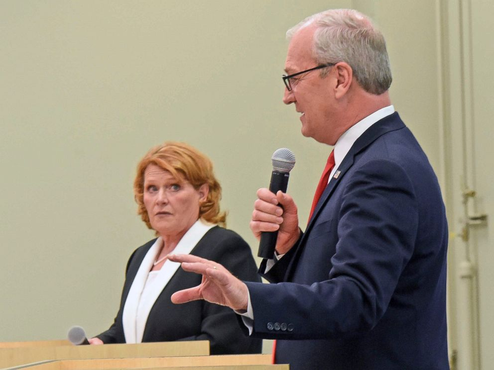PHOTO: Republican U.S. Rep. Kevin Cramer, front, makes a point as North Dakota Democratic U.S. Sen. Heidi Heitkamp listens during the U.S. Senate Candidate Debate on Thursday night, Oct. 18, 2018, in Bismarck, N.D.