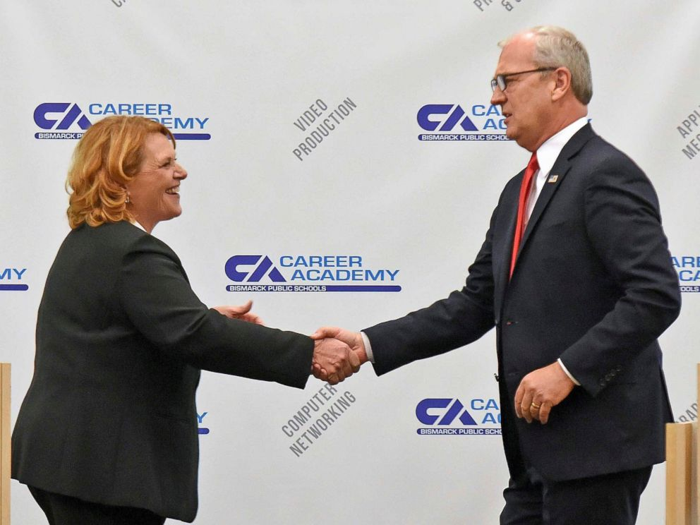 PHOTO: North Dakota Democratic U.S. Sen. Heidi Heitkamp, left, and Rep. Kevin Cramer shake hands at the conclusion of the U.S. Senate Candidate Debate sponsored by the North Dakota Newspaper Association on Thursday, Oct. 18, 2018, in Bismarck, N.D.