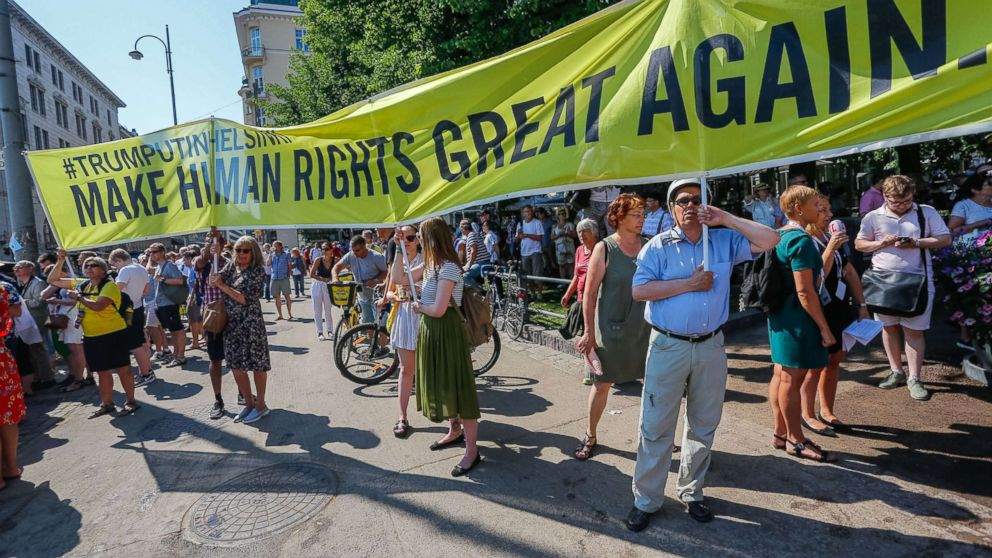 People take part in a demonstration calling for human rights and democracy in Helsinki, Finland, July 16, 2018, on the day of the summit between President Donald Trump and Russian President Vladimir Putin.
