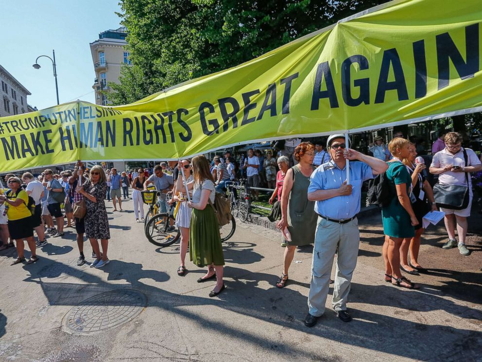 PHOTO: People take part in a demonstration calling for human rights and democracy in Helsinki, Finland, July 16, 2018, on the day of the summit between President Donald Trump and Russian President Vladimir Putin.