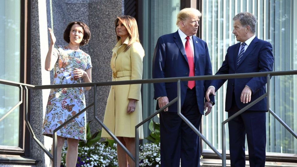 President Donald Trump talks with the President of Finland Sauli Niinisto (right), as  first lady Melania Trump talks  with his spouse Jenni Haukio, left, at the president's official residence in Mantyniemi, in Helsinki, Finland, July 16, 2018.