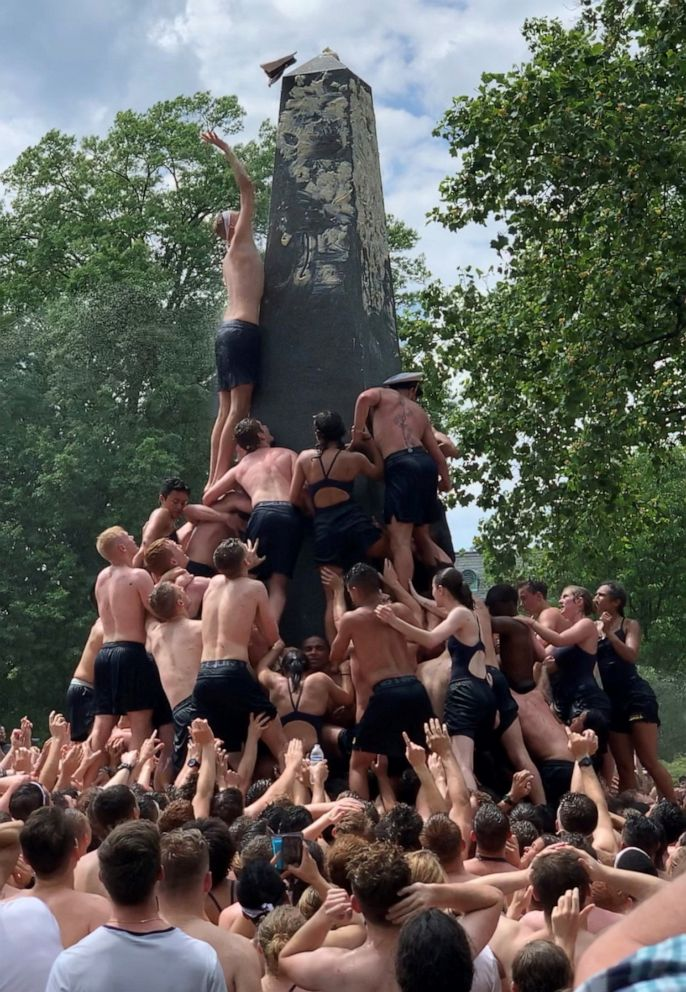 PHOTO: U.S. Naval Academy freshmen climb the Herndon Monument to mark the end of the year, May 20, 2019, in Annapolis, Md.