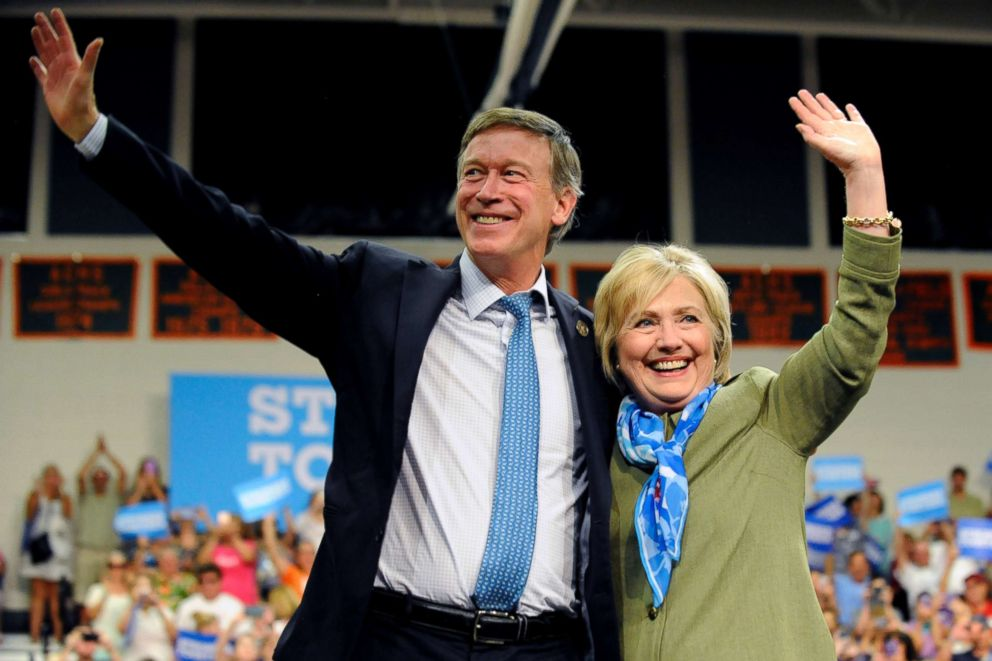 Democratic presidential nominee Hillary Clinton and Colorado Governor John Hickenlooper wave to supporters after her speech at Adams City High School in Commerce City, Colo., Aug. 3, 2016.