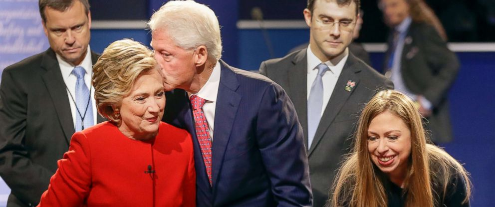 PHOTO: Former President Bill Clinton kisses Democratic presidential nominee Hillary Clinton as she and their daughter Chelsea Clinton greet supports during the presidential debate at Hofstra University in Hempstead, N.Y., Sept. 26, 2016.