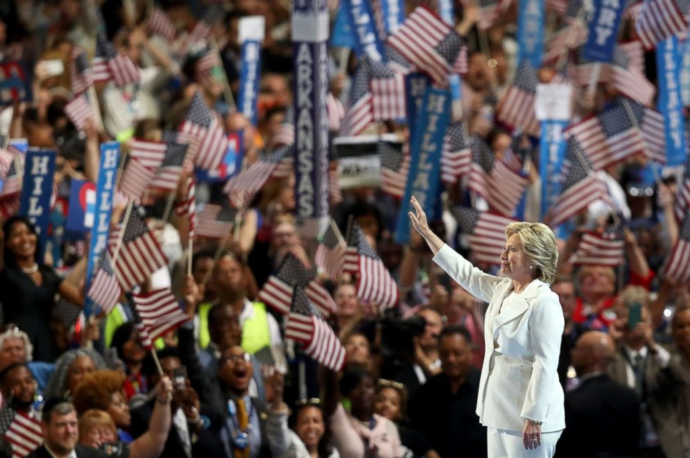 PHOTO: Former Secretary of State Hillary Clinton acknowledges the crowd as she arrives on stage during the fourth day of the Democratic National Convention at the Wells Fargo Center, July 28, 2016 in Philadelphia.