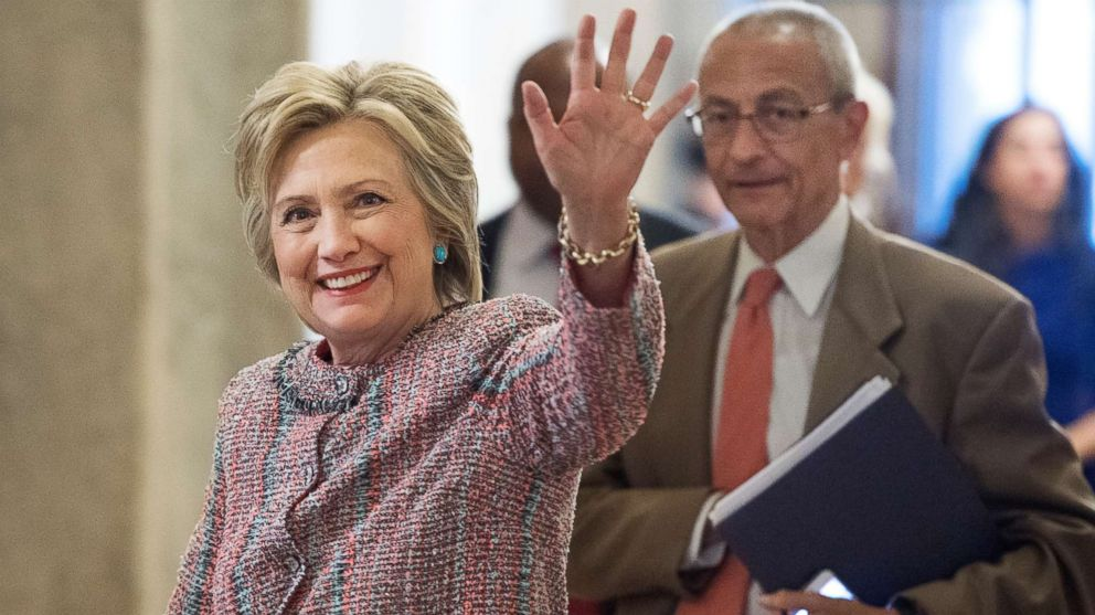 Presidential candidate Hillary Clinton and her campaign chairman, John Podesta, arrive in the Capitol to meet with Senate Democrats, July 14, 2016.