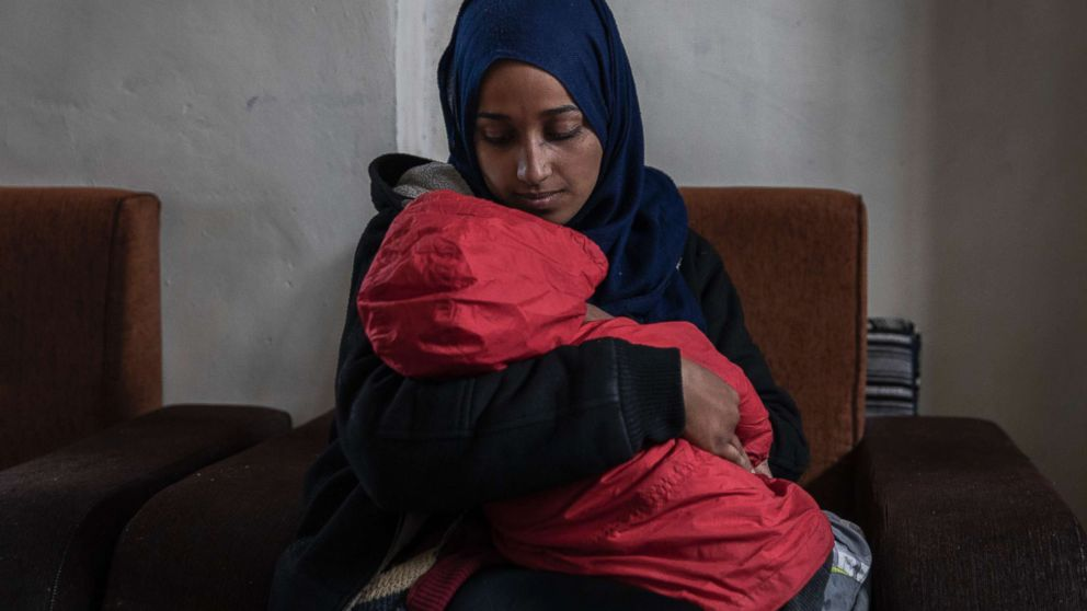 Hoda Muthana, who was born in the United States and joined the Islamic State four years ago, with her son at a detention camp in Al-Hawl, Syria, Feb. 17, 2019.