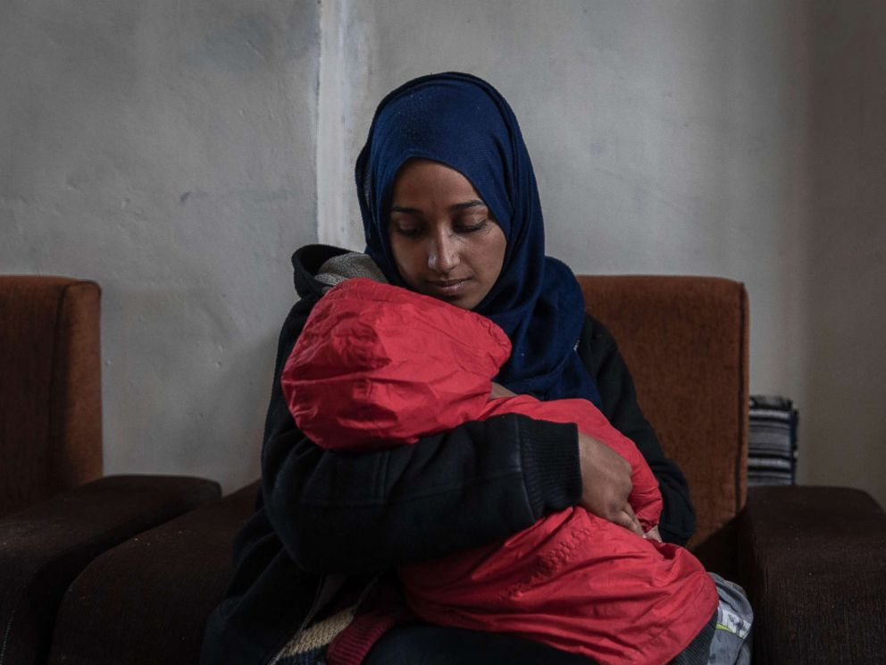 PHOTO: Hoda Muthana, who was born in the United States and joined the Islamic State four years ago, with her son at a detention camp in Al-Hawl, Syria, Feb. 17, 2019.