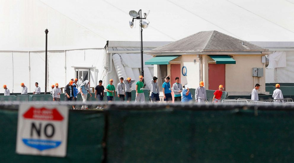 PHOTO: Migrant children who have been separated from their families walk outside shelters at a detention center in Homestead, Fla., June 27, 2019.