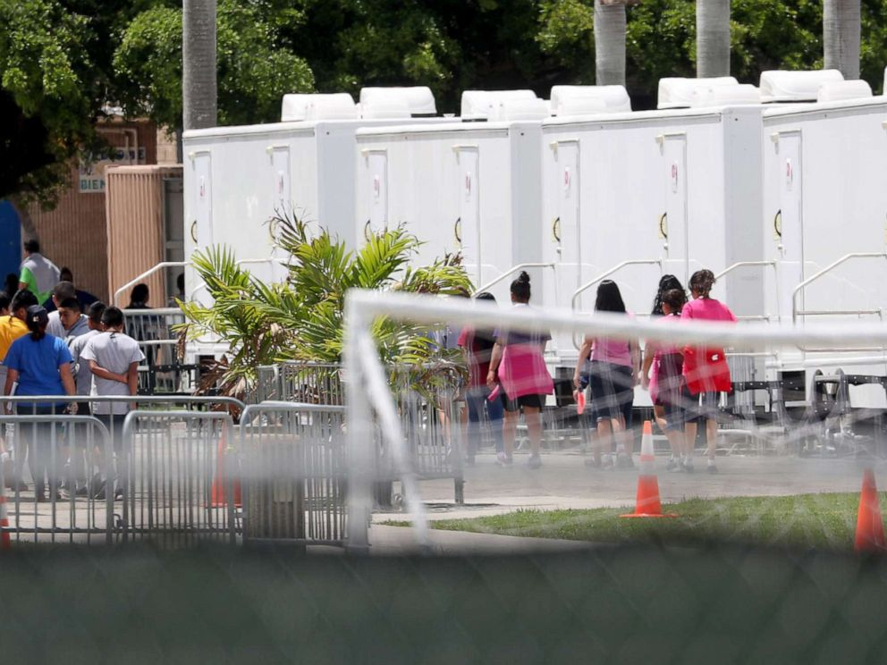 PHOTO: People walk inside the Homestead Temporary Shelter for Unaccompanied Children on June 19, 2018 in Homestead, Fla.