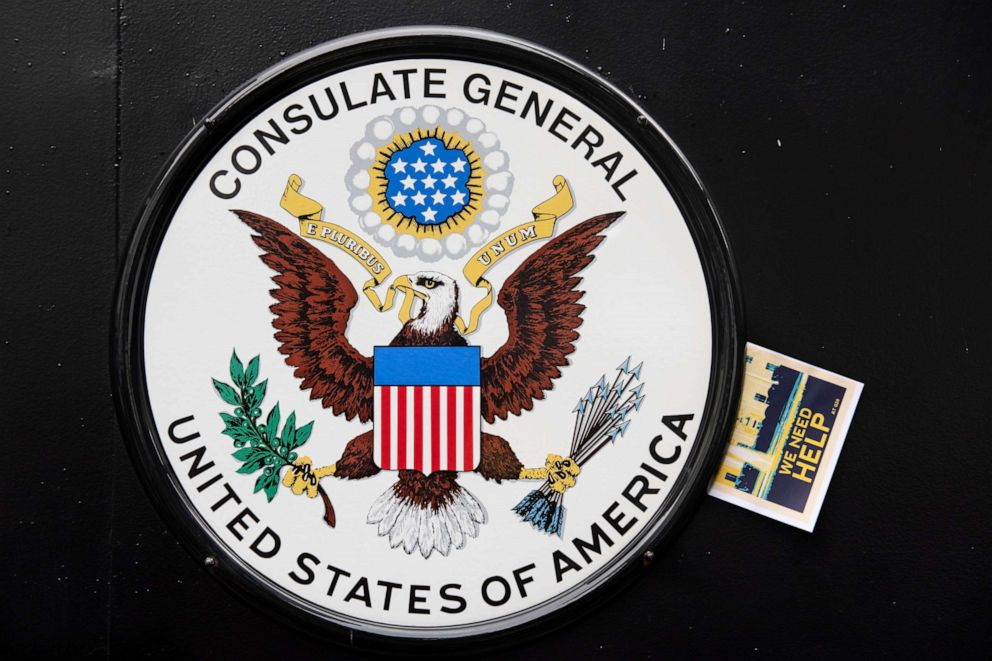 PHOTO: A flyer was put on the U.S. emblem during the protest outside the U.S. General Consulate in Hong Kong.