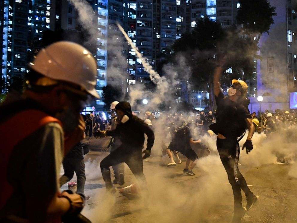 PHOTO: Protesters throw back tear gas fired by the police in Wong Tai Sin during a general strike in Hong Kong on August 5, 2019.