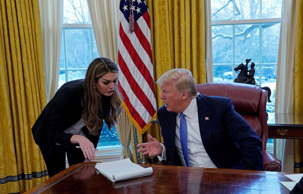 PHOTO: President Donald Trump confers with White House Communications Director Hope Hicks during an interview with Reuters at the White House in Washington, Jan. 17, 2018.