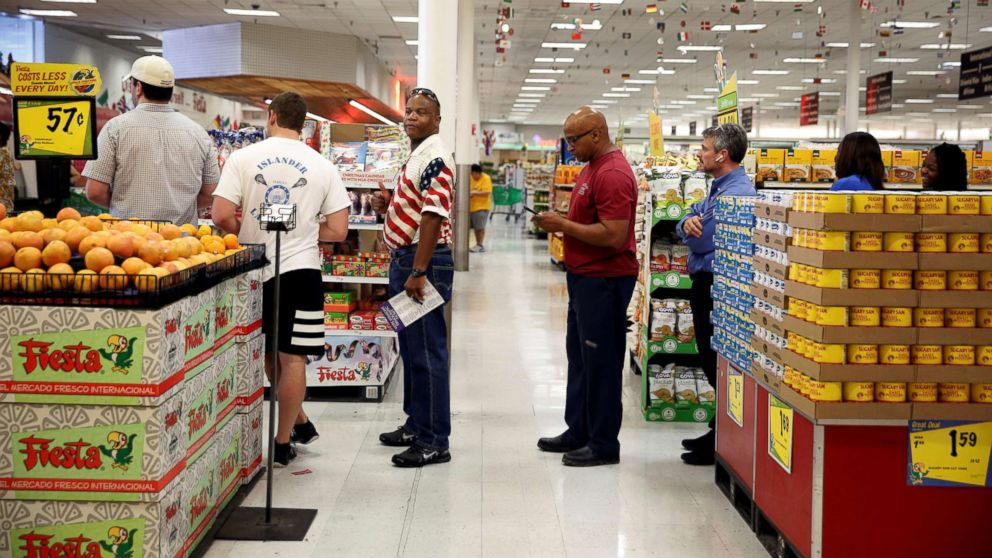 People queue to vote in the midterm elections in a supermarket in Houston, Texas, Nov. 6, 2018.