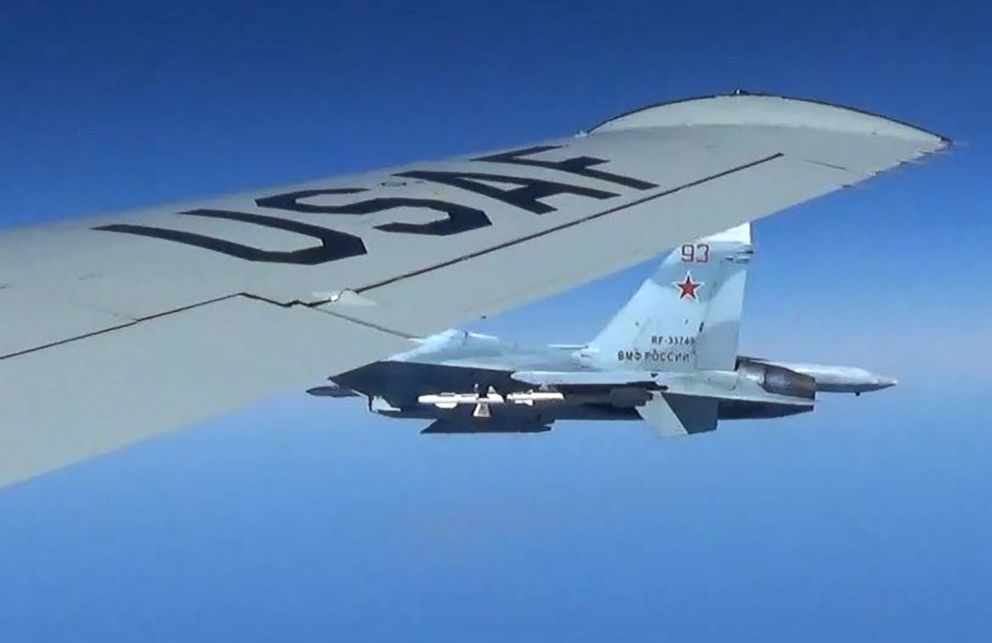 Flanker fighter flies as close as five feet from a RC-135 U.S. Air Force reconnaissance aircraft which was flying in international airspace over the Baltic Sea