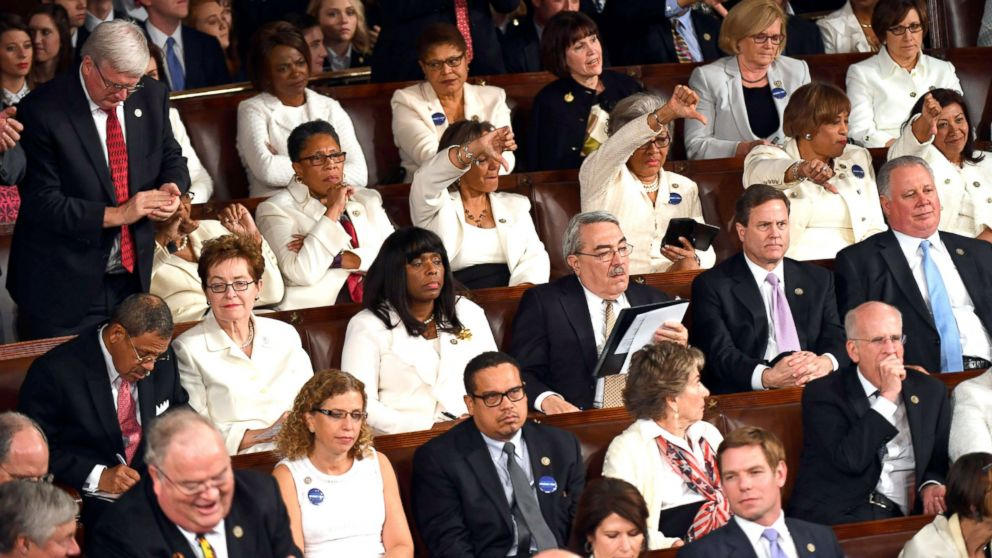 Members of Congress react as President Donald Trump addresses a joint session of Congress on Feb 28, 2017 in Washington, DC.