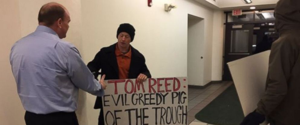 PHOTO: Rep. Tom Reed (D-NY) shakes hands with a protester at a town hall, Feb. 17, 2017.