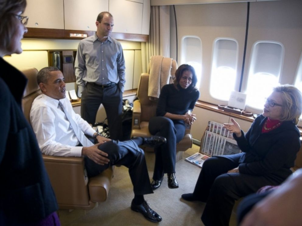 inside air force one obamas bushes clinton bond on way