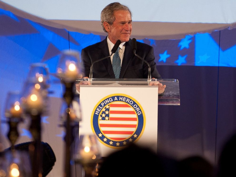 PHOTO: Former President George W. Bush speaks at an event for the Helping a Hero charity in 2012.