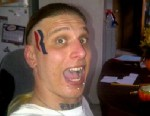 "PHOTO: Eric Hartsburg auctioned off the side of his head where he tattooed Mitt Romneys presidential campaign ""R"" symbol in a 5 by 2 inch spot for $15, 000."