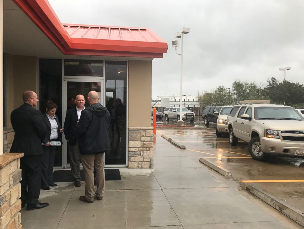 PHOTO: Secret service wait outside a Whataburger in Corpus Christi, Texas, on December 6, 2017, while first lady Melania Trump and second lady Karen Pence order inside.
