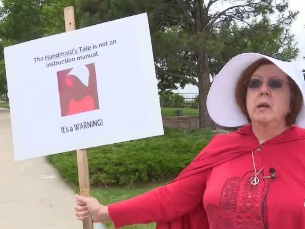 PHOTO: Protesters outfitted in red robes and white bonnets -- the signature get-up worn by handmaids in The Handmaids Tale -- greeted VP Mike Pence outside a speaking engagement in Colorado Springs, Colorado, on June 23, 2017, at Focus on the Family.