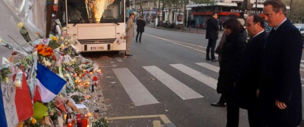 """PHOTO:Prime Minister David Cameron tweeted this photo with the caption, """"President Hollande and I stood shoulder to shoulder outside the Bataclan Cafe in Paris,"""" Nov. 23, 2015."""
