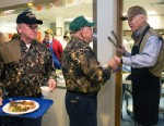 PHOTO: Vice President Joe Biden serves rolls during the Whitehall Neck Sportsman Clubs Wild Game Dinner at the Volunteer Fire Hall in Leipsic, Del., March 4, 2013.
