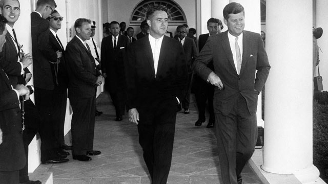 PHOTO: President Kennedy meets with Peace Corps director and brother-in-law R. Sargent Shriver in the West Wing Colonnade on Aug. 28, 1961.