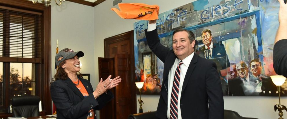 PHOTO: Sen. Kamala Harris, D-Calif., accepts defeat in a friendly World Series bet with Sen. Ted Cruz, R-Tex., in his office in Washington, DC on Nov. 28, 2017.