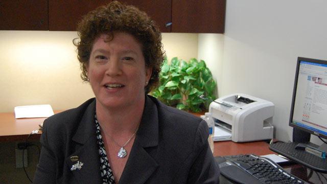 PHOTO: Kemetia Foley sits at her secretarys desk.