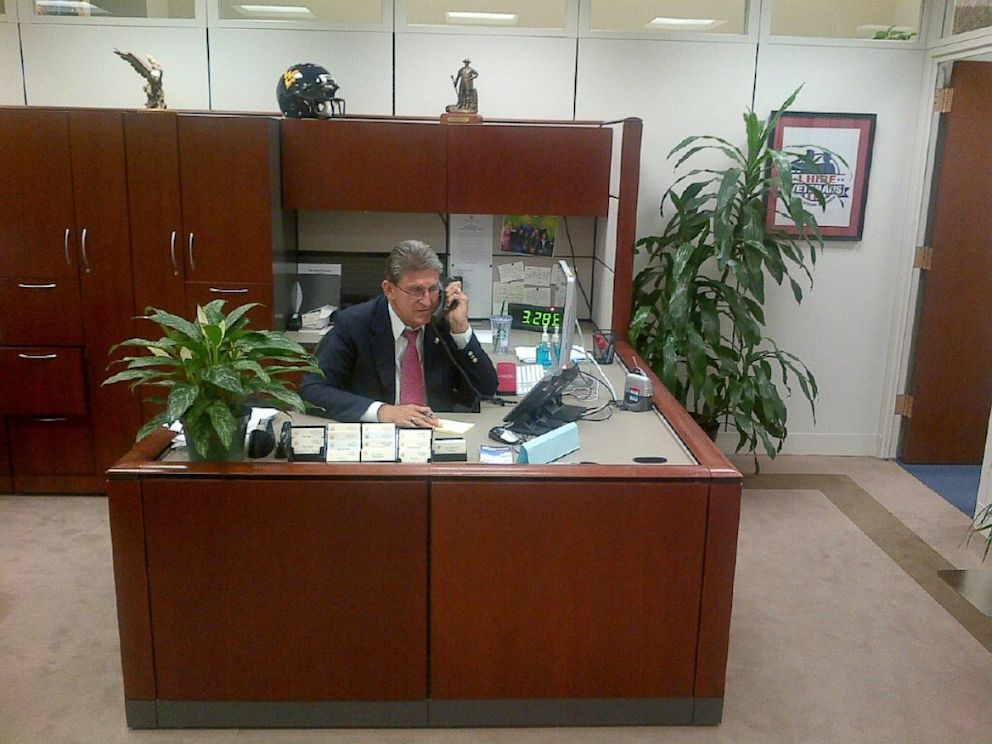 PHOTO: West Virginia Senator Joe Manchin is seen answering his own phones during the government shutdown.