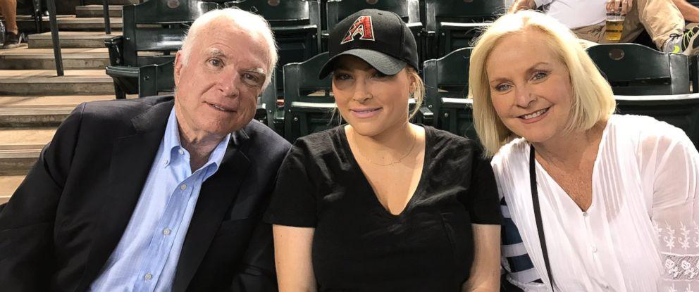 PHOTO: Sen. John McCain, R-Ariz., with wife Cindy McCain and daughter Meghan McCain at an Arizona Diamondbacks game at Chase Arena in Phoenix on August 10, 2017.