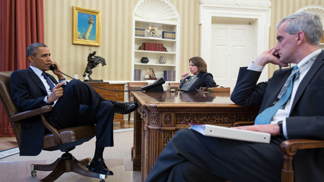 PHOTO: President Barack Obama talks on the phone with FBI Director Robert Mueller to receive an update on the explosions that occurred in Boston, in the Oval Office, April 15, 2013.