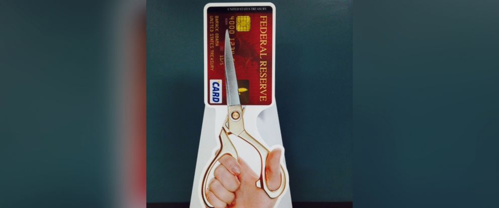 PHOTO: The pop-up visual of a hand cutting an imaginary credit card belonging to the Federal Reserve - part of Rand Pauls new #CutTheirCard campaign.